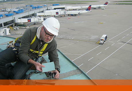 Project Director Chuck Van Winckle reviews tornado damage at the Lambert-St. Louis Airport.