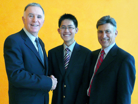 Danny Lee Dian Woon, center, was awarded the first Eli W. Cohen Scholarship by Richard Tomasetti (left) and Joel Weinstein (right).