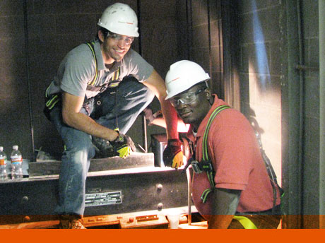 Project Director Mark Andrews, left, and Senior Engineer Eric Wheeler worked on damage assessment of an elevator shaft in Houston, following Hurricane Ike in 2008.